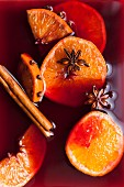 Mulled wine fruit and spice in red wine close up