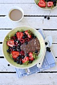 Summer breakfast - chocolate coconut chia pudding with fruits on top.