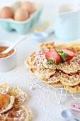 Homemade waffles with apricot jam and strawberries
