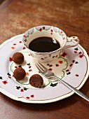 A cup of coffee and chocolate pralines