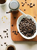 Coffee beans and an espresso jug