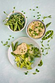 Pea houmous with peas, beans, and pea shoot, view from above