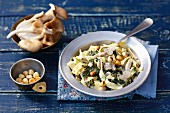 Tagliatelle with oyster mushrooms, spinach, cream and hazelnuts