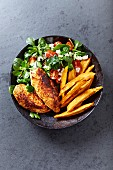 Roasted chicken breast with sweet potato fries and salad