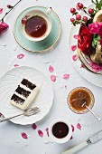 A slice of butttercream layered wedding cake with salted caramel sauce