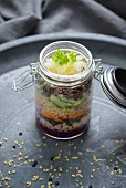Cabbage salad with carrots, cucumber, bulgur wheat and beluga lentils in a glass jar (Vegan)