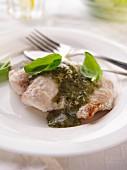 A single serving of pesto fish