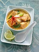 A bowl of Thai salmon laksa