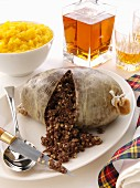 A whole traditional Burns Night haggisspilt open