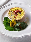 Red pepper and red onion tart with nastutiums editorial food