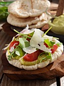 Pitta bread with pesto mayonaise rocket and parmesan shavings
