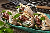 Lamb burgers in pitta bread