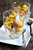 Scrambled eggs with bacon and chives in a glass