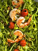 Green pasta with prawns and cocktail tomatoes