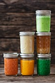 Various soups in screw-top jars
