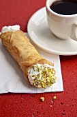 Canoli with pistachio and black coffee