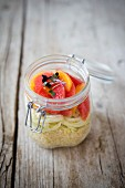 Bulgur salad with fennel and citrus fruits in a glass jar with lid