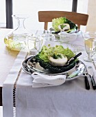 Set table decorated with cheese in cabbage leaves