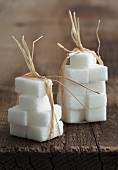 Sugar cubes tied together with raffia ribbon