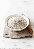 Organic whole rye flour in a bowl
