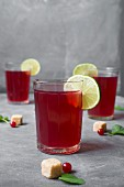 Red tea in glasses, decorated with lime slices