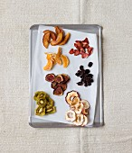 Various dried fruits on a baking tray