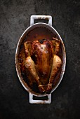 A whole chicken in a roasting tin