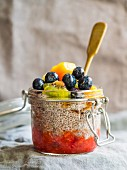 Overnight chia pudding with red fruit mousse and fesh fruit