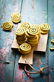 Savoury curry and poppyseed pinwheels on a chopping board