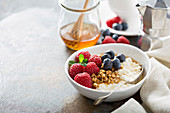 Cottage cheese for breakfast with granola, honey and raspberry