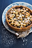 A mince pie with dried fruits and pastry stars