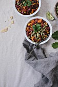 Two bowls of sweet potato and corn chocolate chili