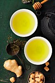 Cups with green tea on wooden background