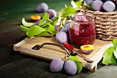 Sweet plums on wooden background, bio healthy fruits