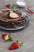 Chocolate Crepes with Strawberry and Icing Sugar