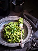 Raw vegan zucchini pasta with green pesto