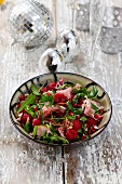 Rocket salad with raspberries, Parma ham and pecan nuts