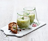 Herb and potato soup in glasses