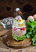 Buckwheat salad with egg and radish in a jar