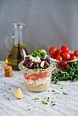 Quinoa salad with feta, tomatoes and kalamata olives in a glass jar