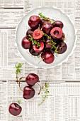 Fresh Cherries and Thyme on newspaper