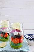 Greek salad in a glass jar