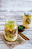 Mushroom and spring onion soup with rice noodles in a glass jar (Asia)