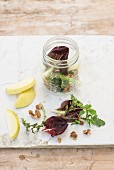 Mixed leaf lettuce with apple in a glass jar