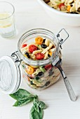 Mediterrean pasta sald in a jar, sardinian gnocchetti, cherry tomato, spring onions and basil