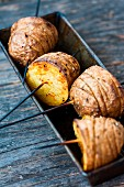 Hasselback potato halves on skewers