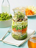 Layered salad with shoots, carrots and soya beans (Asia)