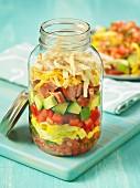 Breakfast burrito in a glass jar