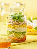 Spring roll salad with chilli sauce in a glass jar (Asia)