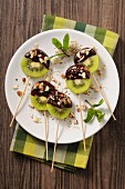Chocolate and kiwi lollies with chopped nuts